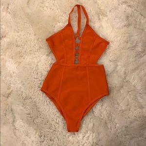 Orange bandage one piece bathing suit.